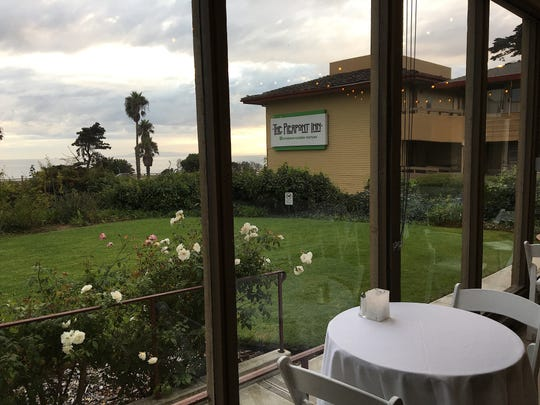 A table-for-two is seen on the glassed-in patio that currently serves as Austen's Restaurant at the Pierpont Inn in Ventura.