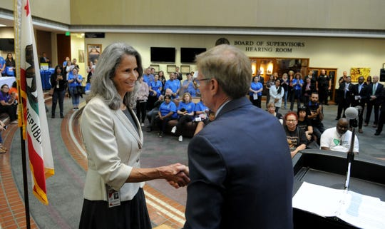 County Supervisor Linda Parks accepts an award from District Attorney Greg Totten during the annual ceremony marking National Crime Victims Rights Week at the Ventura County Government Center. Parks was recognized for her work helping Borderline shooting victims.