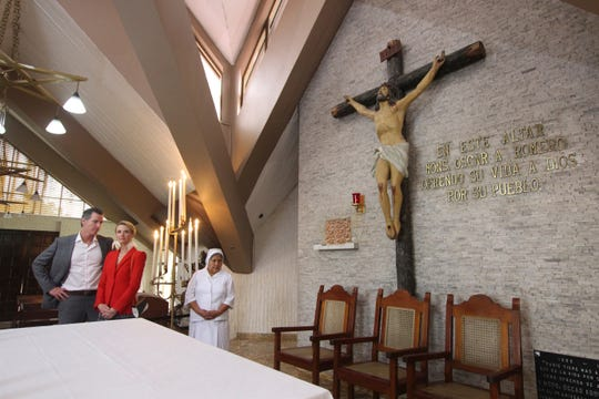 California Gov. Gavin Newsom, left, and his wife, Jennifer Siebel Newsom, visit the Divine Providence Chapel where Monsignor Oscar Arnulfo Romero was assassinated by a gunman in 1980. The visit came Tuesday during the Newsoms' three-day visit in San Salvador, El Salvador. At right, Salvadoran nun Maria Julia Garcia accompanies them.