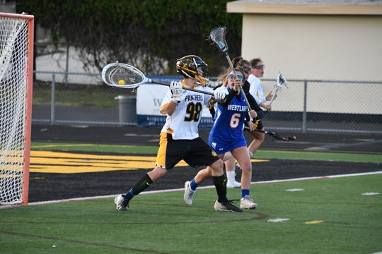 Goalie Daniella Guyette, shown being put under pressure by Westlake's Julia Dinerman on March 22, is an exciting newcomer for the Newbury Park High girls lacrosse team.
