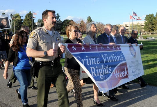 Sheriff Bill Ayub and other county officials march during the annual ceremony marking National Crime Victims' Rights Week at the Ventura County Government Center.