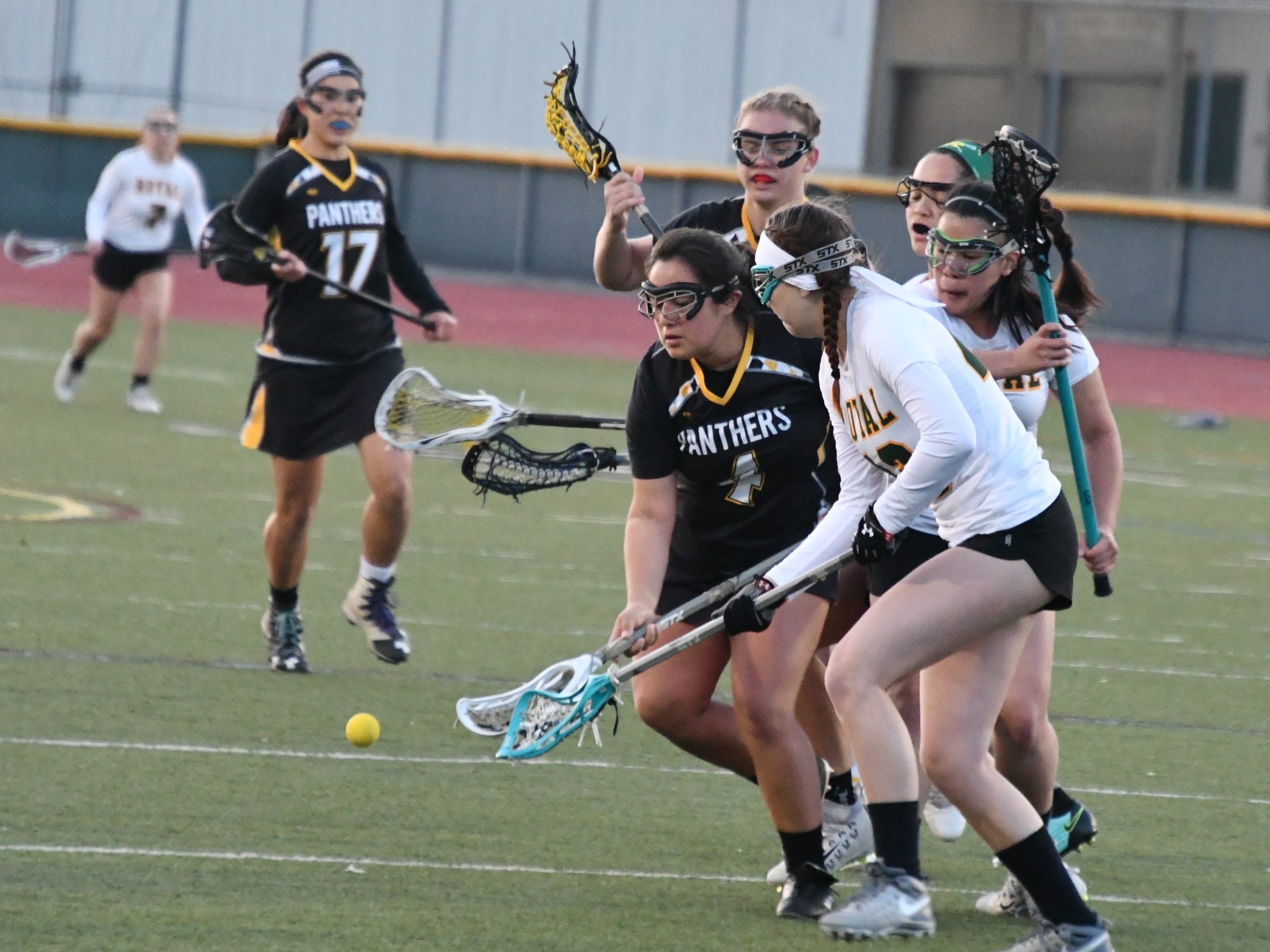 Newbury Park senior Katryna De La Cruz scoops up a ground ball at Royal High on March 7. The Panthers won, 24-3.