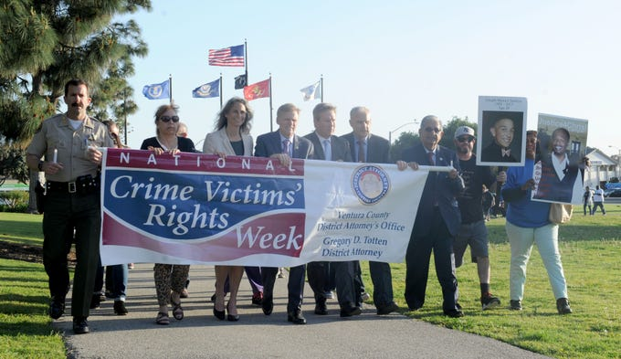County officials march along with Greg Totten, district attorney, during the annual ceremony for National Crime Victims' Rights Week at the Ventura County Government Center.