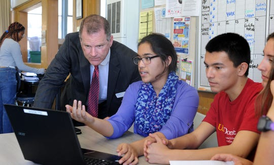 Roger Rice, the new superintendent for Ventura Unified School District, from left, visits with Labiba Sardar, Daniel Perez and Dani Barbar at Buena High School ASB room. Rice's mission is to visit all the schools in the district within six weeks of starting the job.