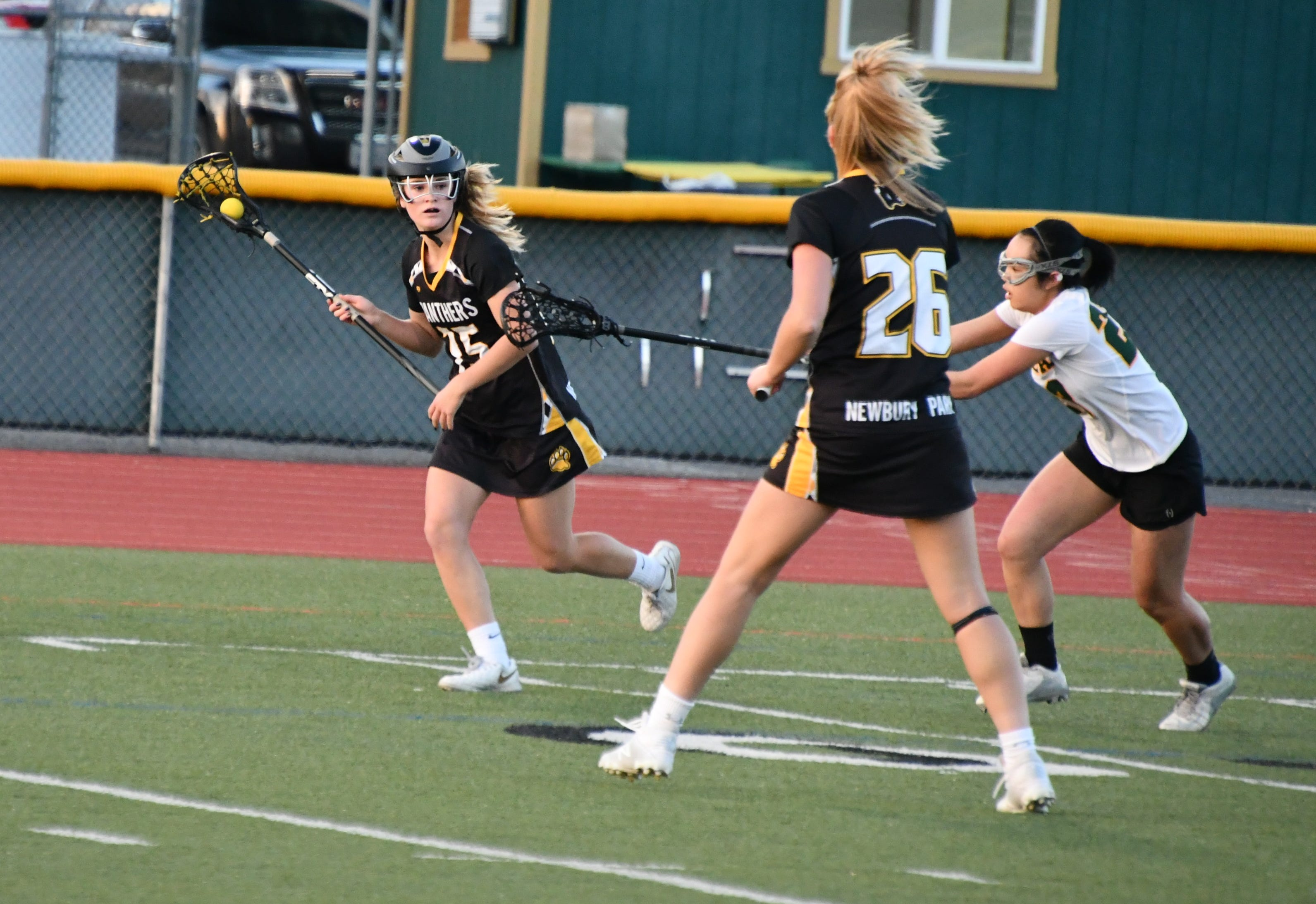 Newbury Park sophomore attacker Emma Ing looks for a teammate at Royal High on March 7.  The Panthers won, 24-3.