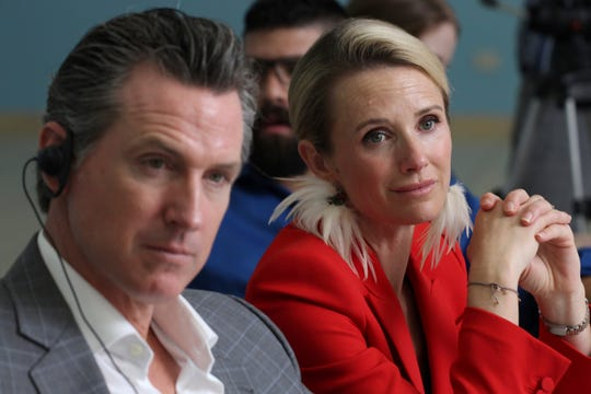 California Gov. Gavin Newsom and his wife, Jennifer Siebel Newsom, listen to rehabilitation experiences made by non-governmental organizations made in favor of Salvadoran gang members, during a meeting at the Divina Providencia Hospital facility in San Salvador, El Salvador, on Tuesday.
