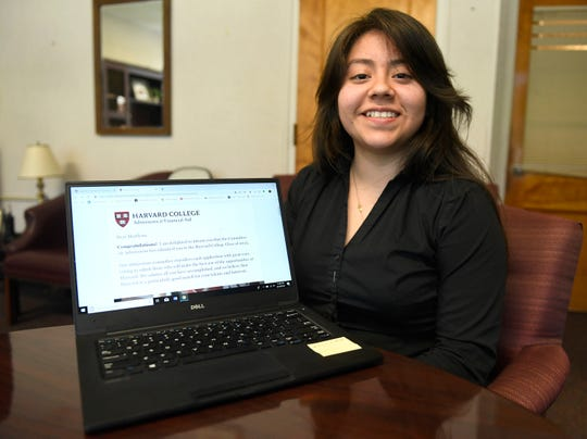 Marilynn Miguel, a senior at Vineland High School, shows off her acceptance letter to Harvard University. Miguel has been offered a full ride to the Ivy League school.