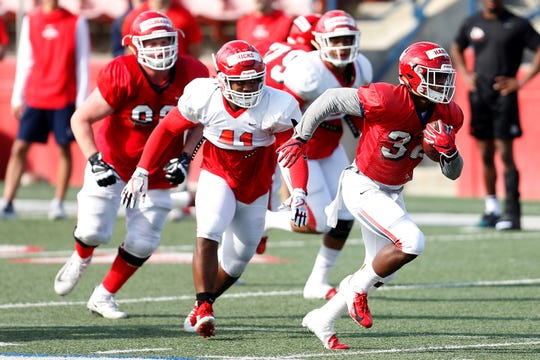 Fresno State running back Romello Harris, right, is taking first- and second-team reps with the Bulldogs' football team this spring.