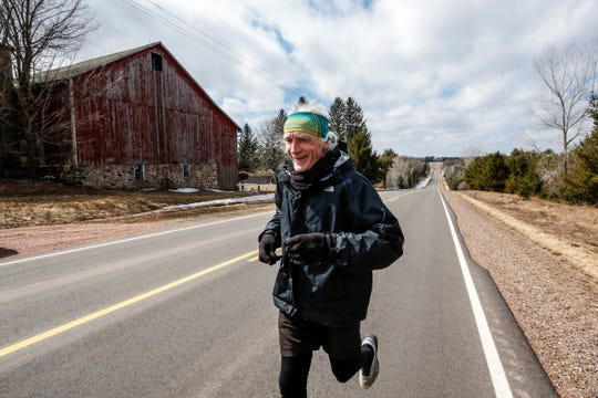 "Allan ""Fish"" Stieber, of Owen, runs during his training Wednesday, April 3, 2019, on County Road U in Rib Falls, Wis."
