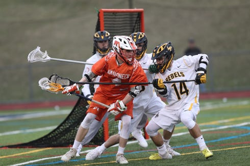 Mamaroneck's Tom Conley (4) works againstst Lakeland/Panas' Mike Castelli (14) during boys lacrosse action at Walter Panas High School in Cortlandt on Tuesday, April 9, 2019.