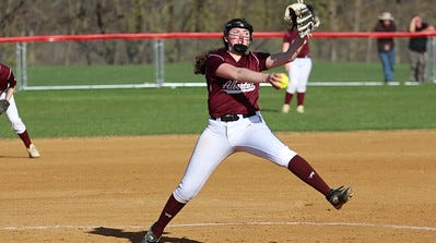 Albertus Magnus pitcher Kelly O'Brien delivers a pitch during a game.
