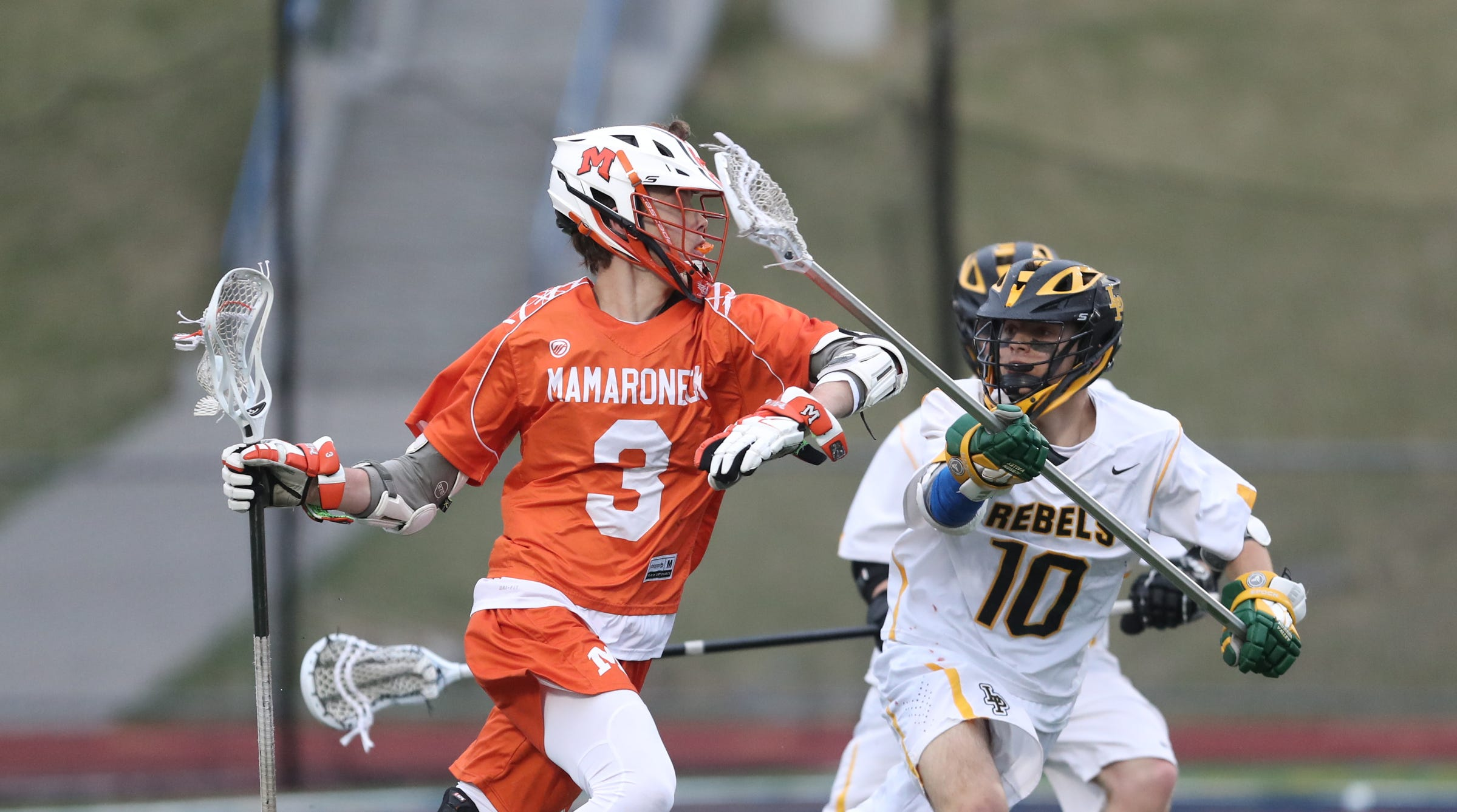 Mamaroneck's Wills Martin (3) works againstst Lakeland/Panas' Mark Cummins (10) during boys lacrosse action at Walter Panas High School in Cortlandt on Tuesday, April 9, 2019.