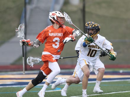 Mamaroneck's Will Martin (3) works againstst Lakeland/Panas' Mark Cummins (10) during boys lacrosse action at Walter Panas High School in Cortlandt on Tuesday, April 9, 2019.