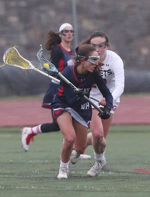 Callie Hoffman of Byram Hills drives against Rye during an April 9, 2019 girls lacrossse game. Hoffman will play for the University of Chicago next year.