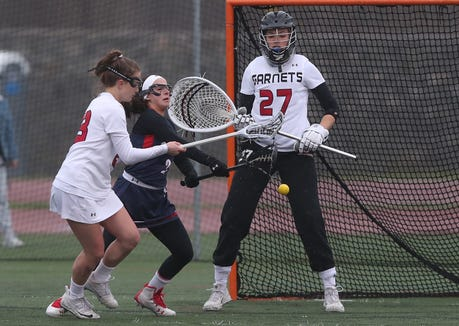 Rye's Claudia Rafa (23) and Byram Hills' Hallie Remnitz (2) battle for ball control in front of Rye goalie Amelia Cunningham (27) during girls lacrosse action at Rye High School April 9,  2019. Rye won the game 12-9.