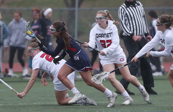 Byram Hills' Kallie Hoffman (6) drives to the goal against Rye during girls lacrosse action at Rye High School April 9,  2019. Rye won the game 12-9.