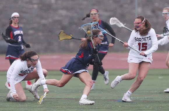 Byram Hills drives on Rye during last week's game. No. 3 Rye beat the No. 10 Bobcats 12-9.
