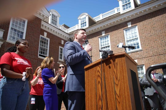 Sen. Bryan Townsend speaks to a crowd of gun control advocates outside Legislative Hall on Wednesday.