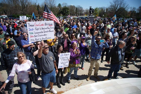 Opposers protest at a rally where lawmakers and advocates gathered outside Legislative Hall on Wednesday.