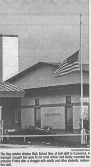 An American flag flies at half-staff at Weston High School in this photo published in the Stevens Point Journal on September 30, 2006. A student at the high school shot and killed principal John Klang on September 29, 2006.