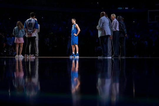 Dallas Mavericks forward Dirk Nowitzki (41) is honored by team owner Mark Cuban and head coach Rick Carlisle after the game against the Phoenix Suns at the American Airlines Center.