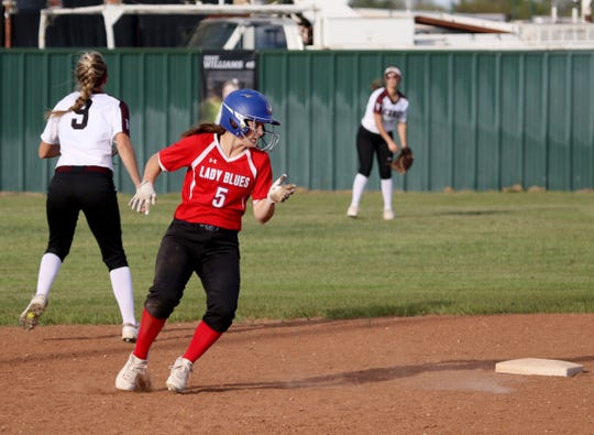 Graham's Callie Dobbs stops at second in the game against Vernon Tuesday, April 9, 2019, in Vernon. The Lady Blues defeated the Lady Lions 6-2.