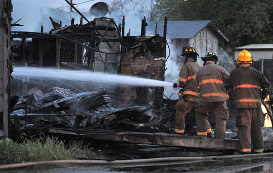 In this file photo, Wichita Falls firefighters work to control a three-alarm fire on Ave. F. The department is returning to in-house training after having training for a time at Vernon College in an effort to save money.