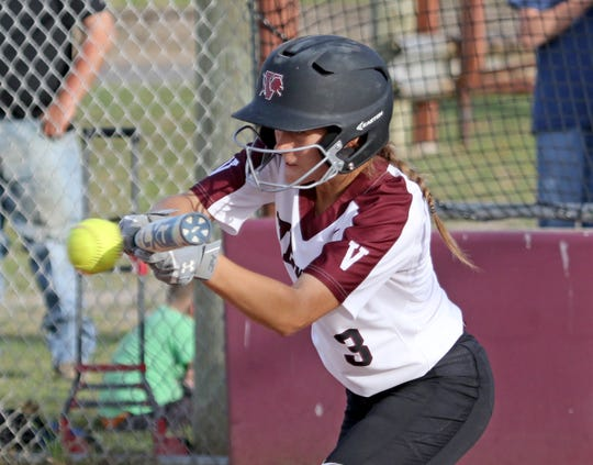 Vernon's Addison Spencer bunts in the game against Graham Tuesday, April 9, 2019, in Vernon. The Lady Blues defeated the Lady Lions 6-2.