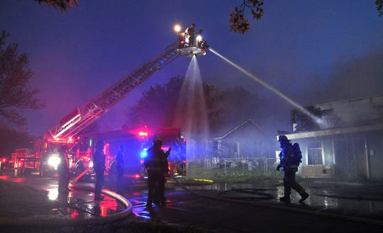 Wichita Falls firefighters work to control a three-alarm fire early Wednesday morning in the 2200 block of Avenue F.