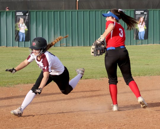 Vernon's Caitlin Brints falls after being tagged by Graham's Alex Husen Tuesday, April 9, 2019, in Vernon. The Lady Blues defeated the Lady Lions 6-2.
