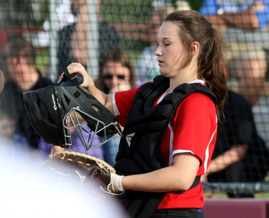 Graham's Callie Dobbs puts on her helmet in the game against Vernon Tuesday, April 9, 2019, in Vernon. The Lady Blues defeated the Lady Lions 6-2.