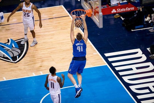 Dallas Mavericks forward Dirk Nowitzki (41) dunks the basketball during the second half against the Phoenix Suns at the American Airlines Center.