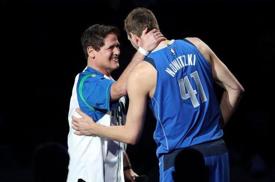 Mavericks owner Mark Cuban embraces Dirk Nowitzki after Tuesday's game.