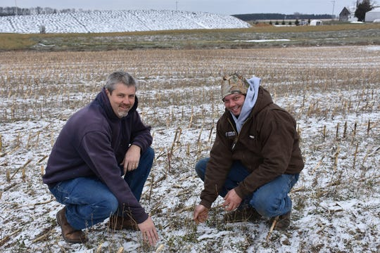 Barry Bubolz (left) NRCS Area GLRI Coordinator, with Aaron Augustian, of Augustian Farms LLC, check covers over winter.