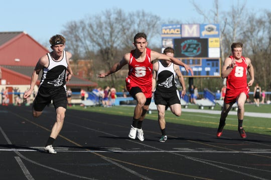 New Lexington's C.J. Ratliff, left, Sheridan's Jacob Rhodes, New Lexington's Jacob Vance and Sheridan's Alec Ogle finish the 100 meter dash during Tuesday's tri-meet between Sheridan, New Lexington and host Maysville.