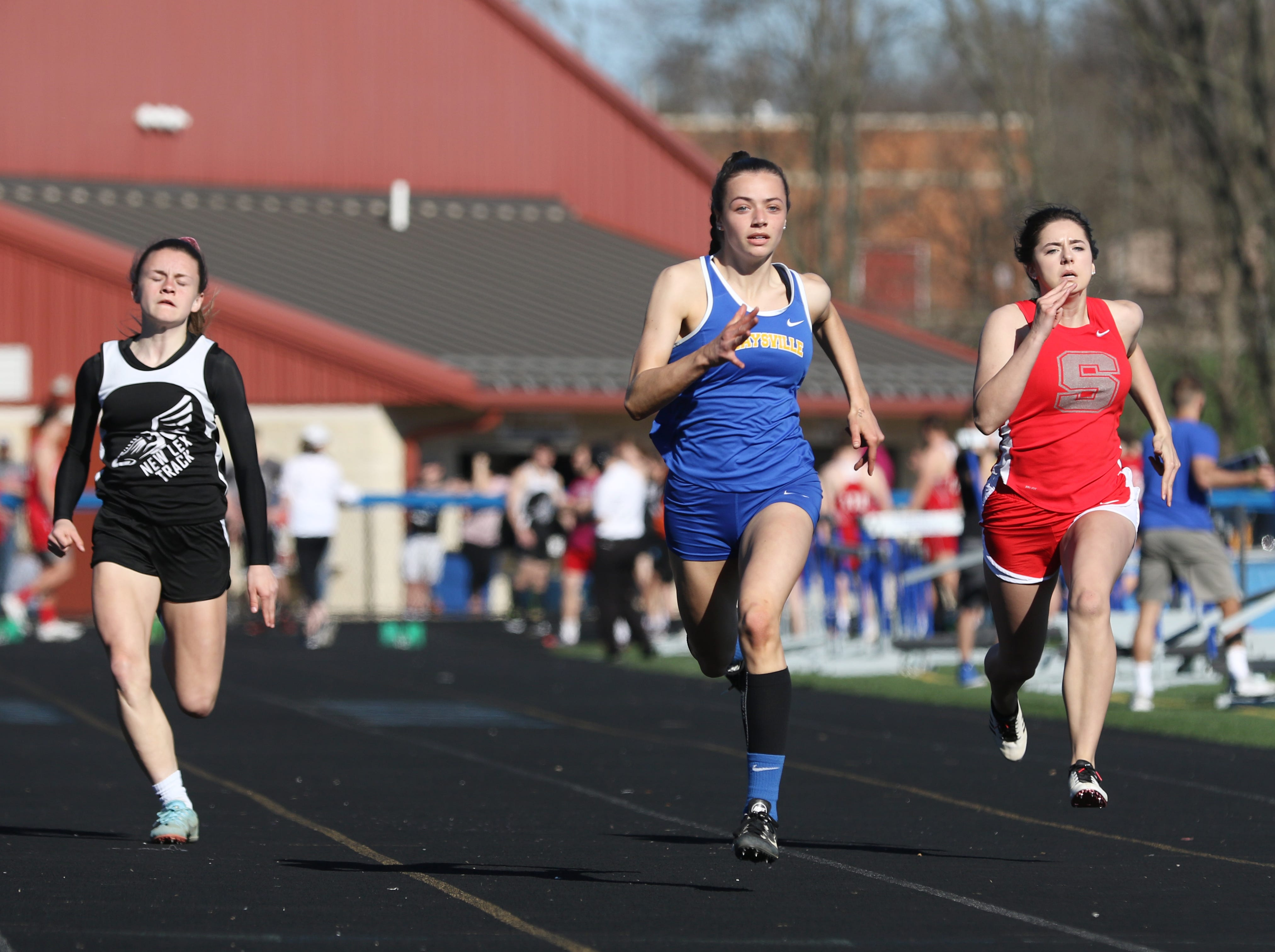 Maysville's Paige Webb wins her heat of the 100 meter dash during Tuesday's tri-meet between Sheridan, New Lexington and host Maysville.