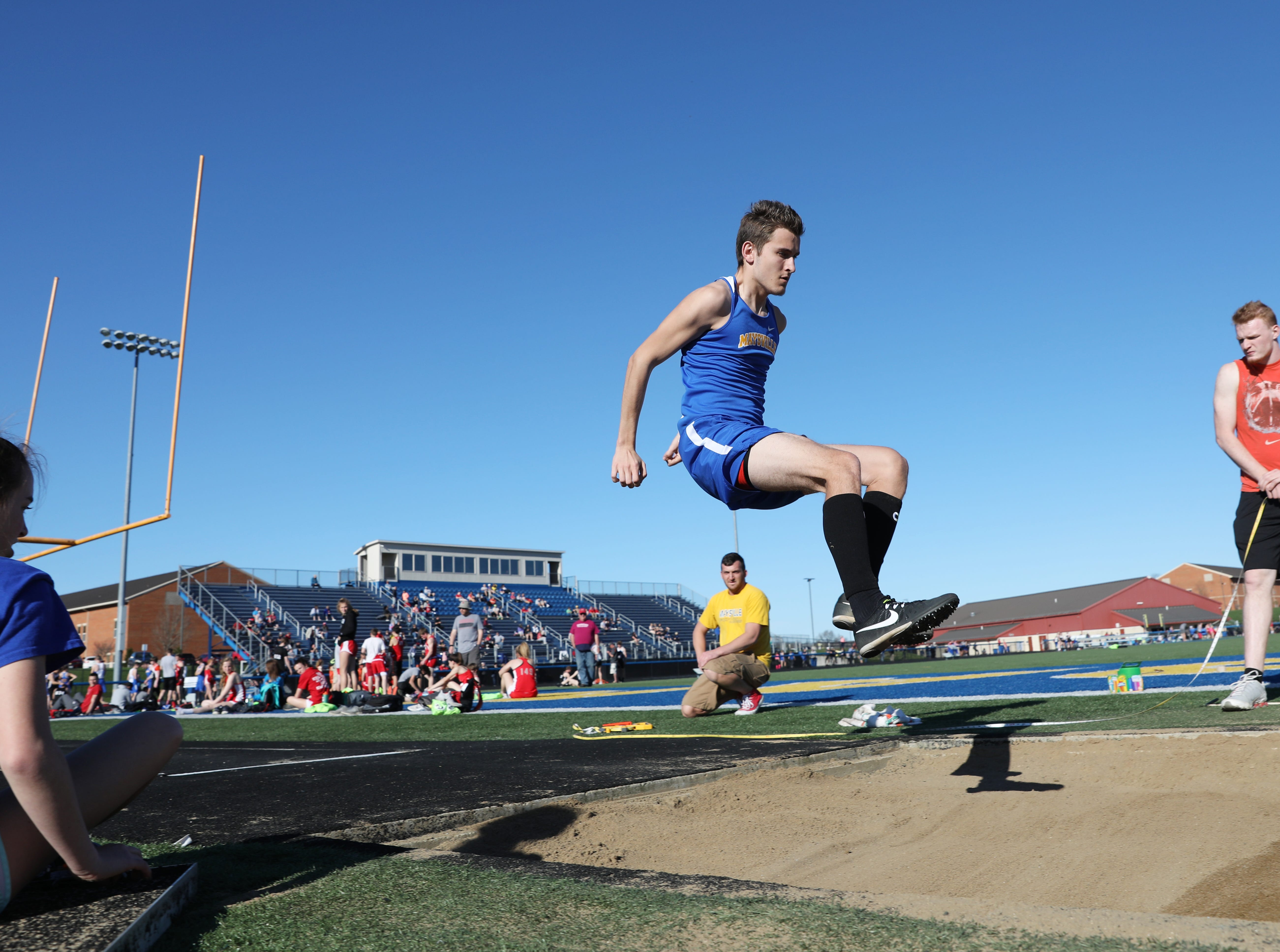 Maysville's Brodee Creeks competes in the long jump during Tuesday's tri-meet between Sheridan, New Lexington and host Maysville.