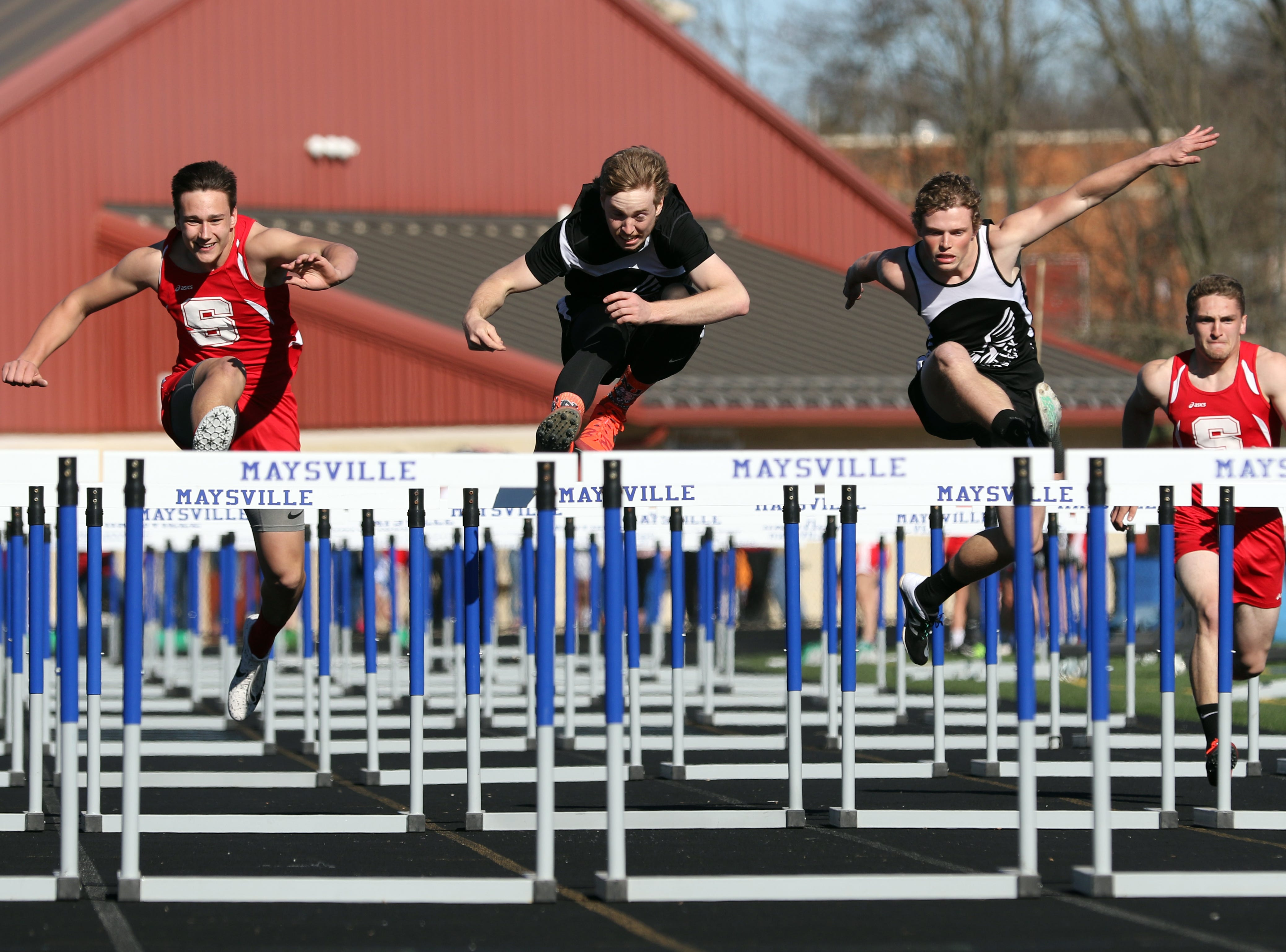 New Lexington's Jacob Vance leads Sheridan's Graham Grant and fellow panther Austin Tharp toward the last hurdle in the 110 meter hurdles during Tuesday's tri-meet between Sheridan, New Lexington and host Maysville.