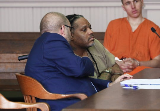 Gerald Draughn consults with his attorney Keith Edwards during his hearing Wednesday. Draughn pleaded guilty to 13 counts of drug trafficking and possession.