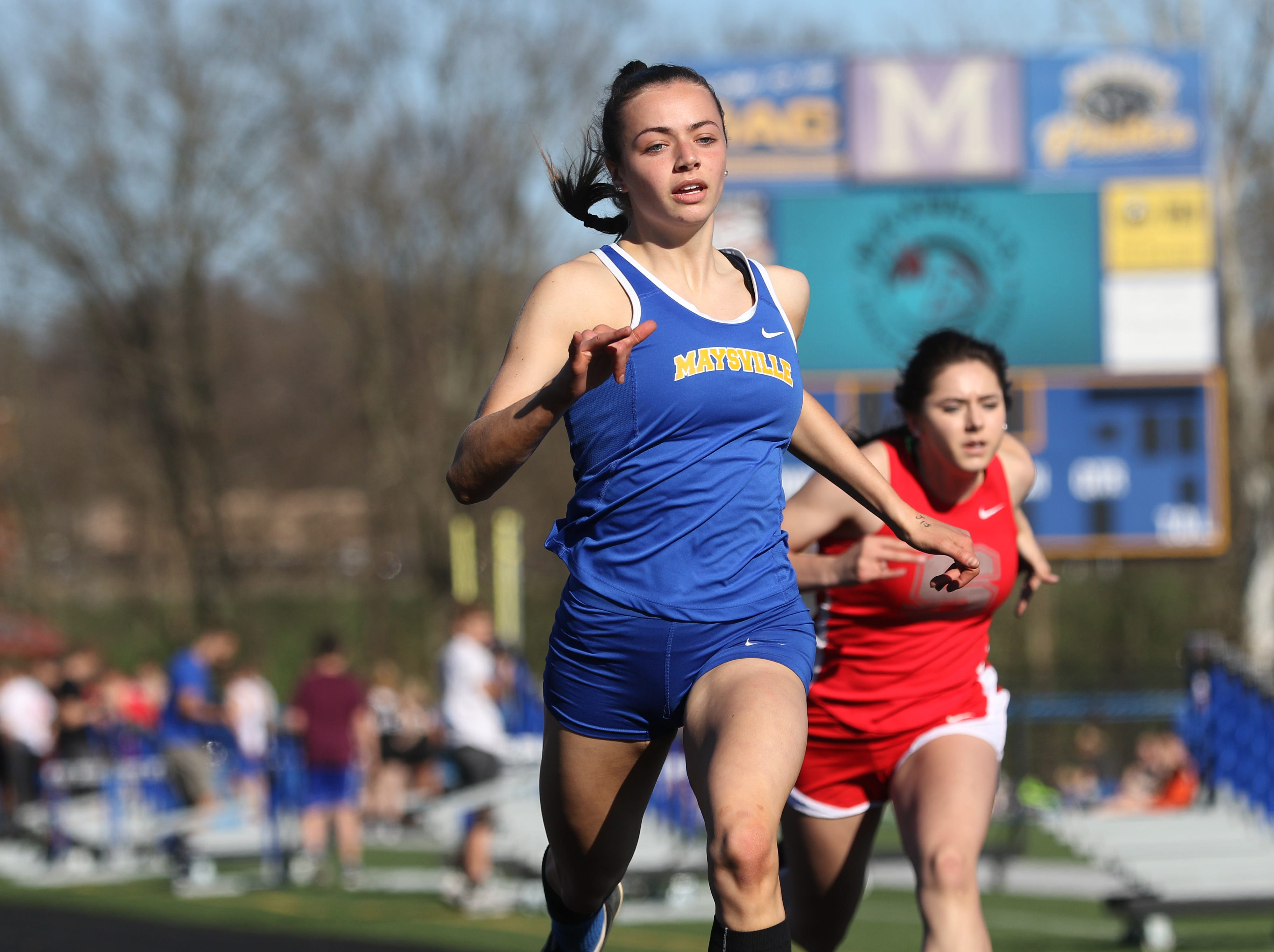 Paige Webb wins her heat of the 100 meter dash during Tuesday's tri-meet between Sheridan, New Lexington and host Maysville.