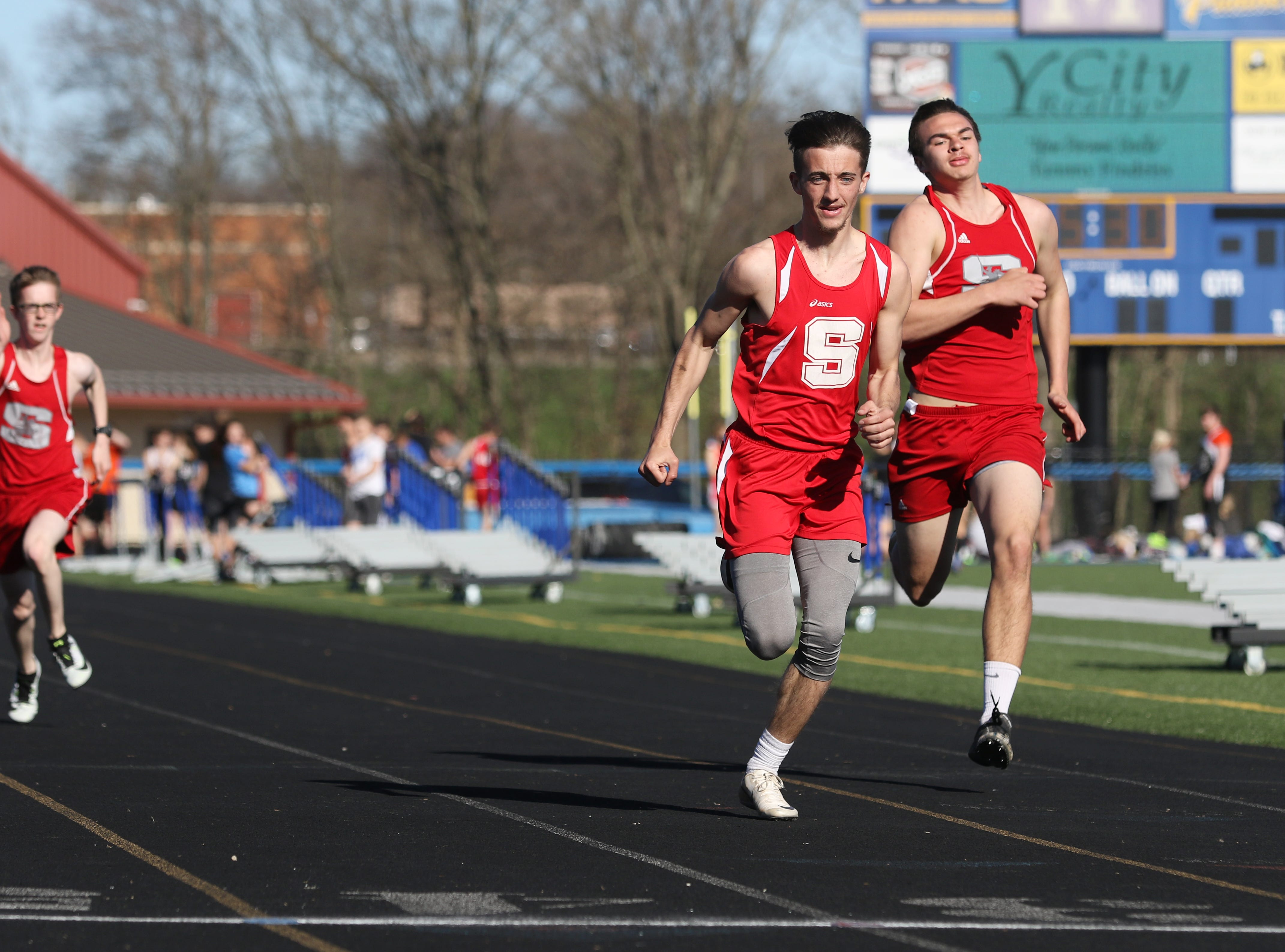 Sheridan's Tayden Sabo wins his heat of the 100 meter dash during Tuesday's tri-meet between Sheridan, New Lexington and host Maysville.