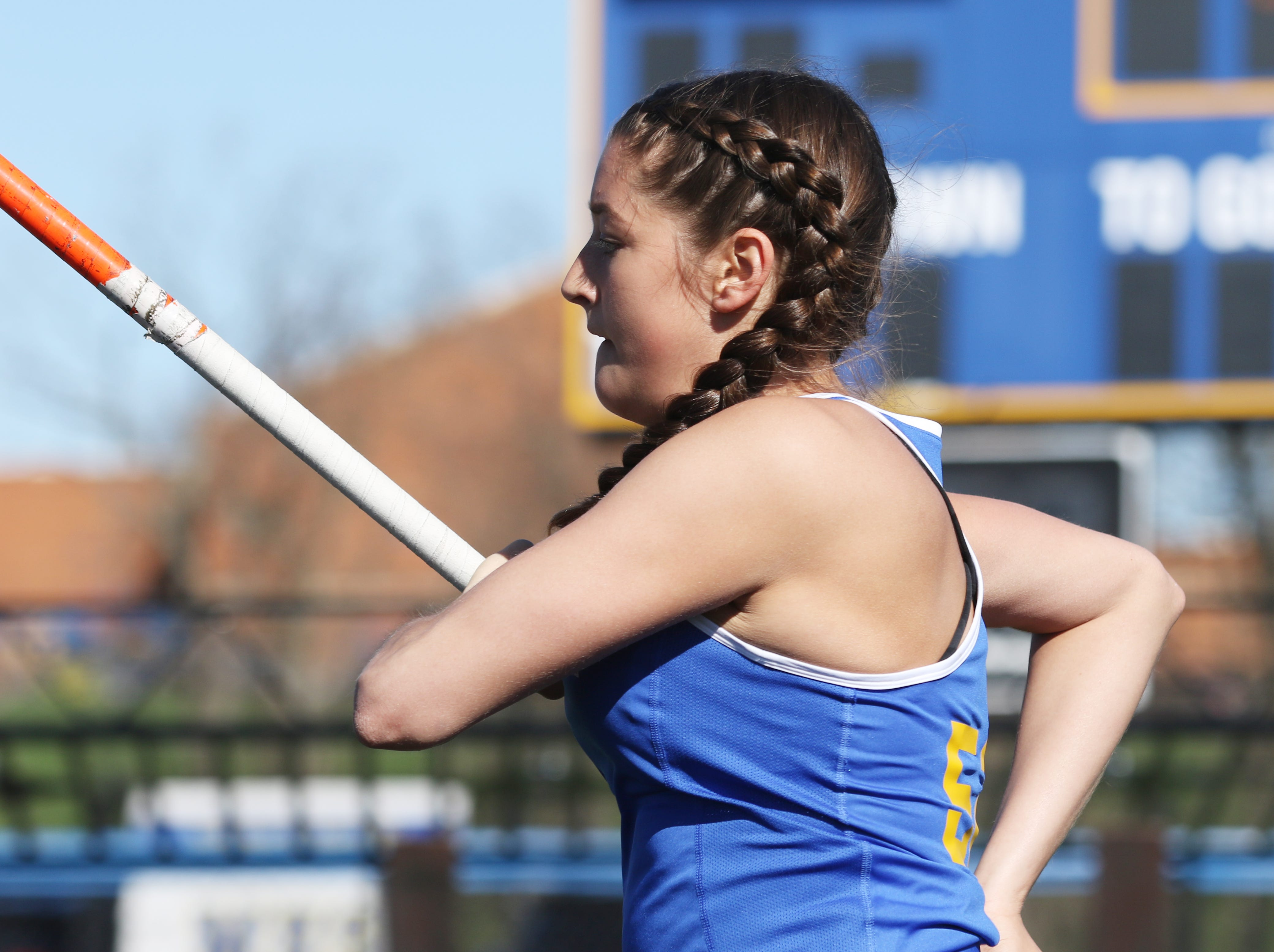 Maysville's Raeann Wilkes competes in the pole vault during Tuesday's tri-meet between Sheridan, New Lexington and host Maysville.