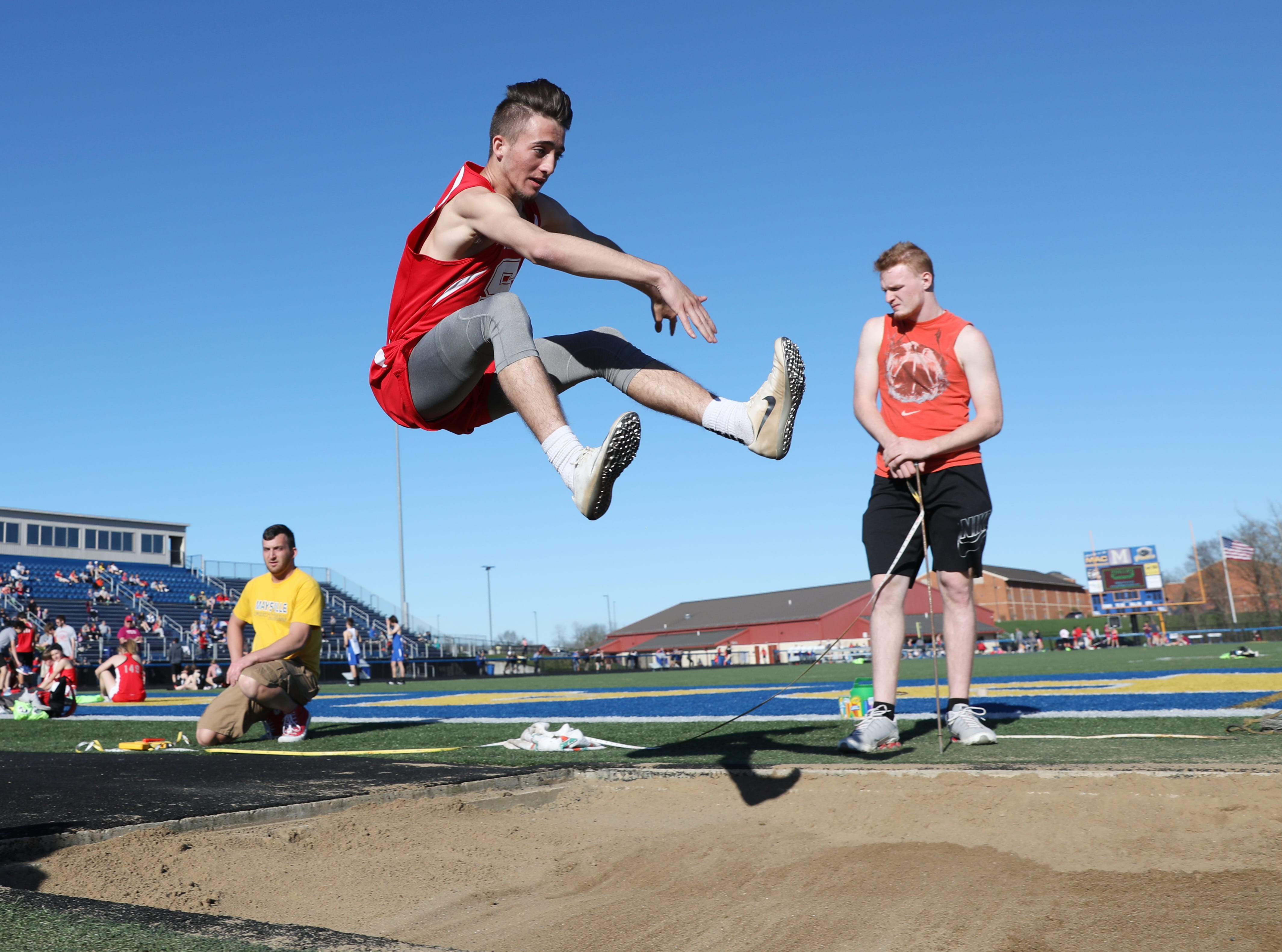 Sheridan's Tayden Sabo competes in the long jump during Tuesday's tri-meet between Sheridan, New Lexington and host Maysville.