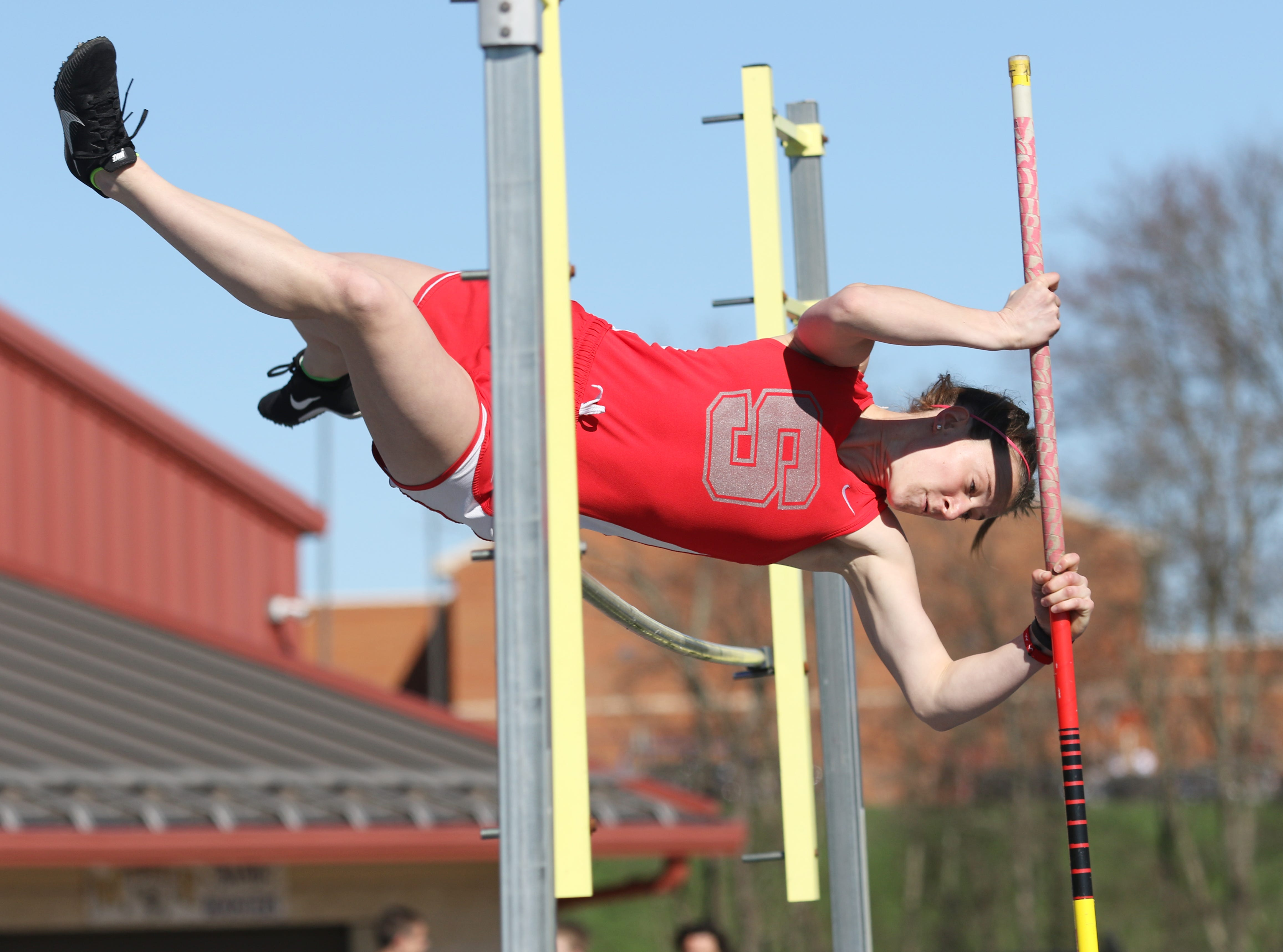 Sheridan's Sydney Bradley competes in the pole vault during Tuesday's tri-meet between Sheridan, New Lexington and host Maysville.