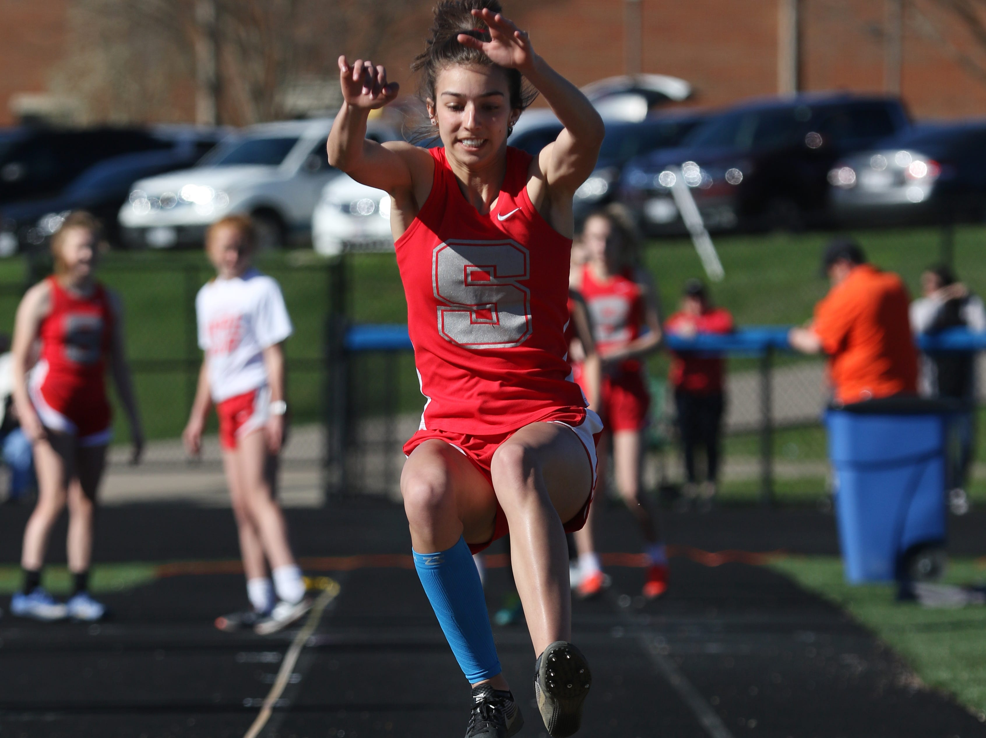 A Sheridan jumper competes in the long jump during Tuesday's tri-meet between Sheridan, New Lexington and host Maysville.