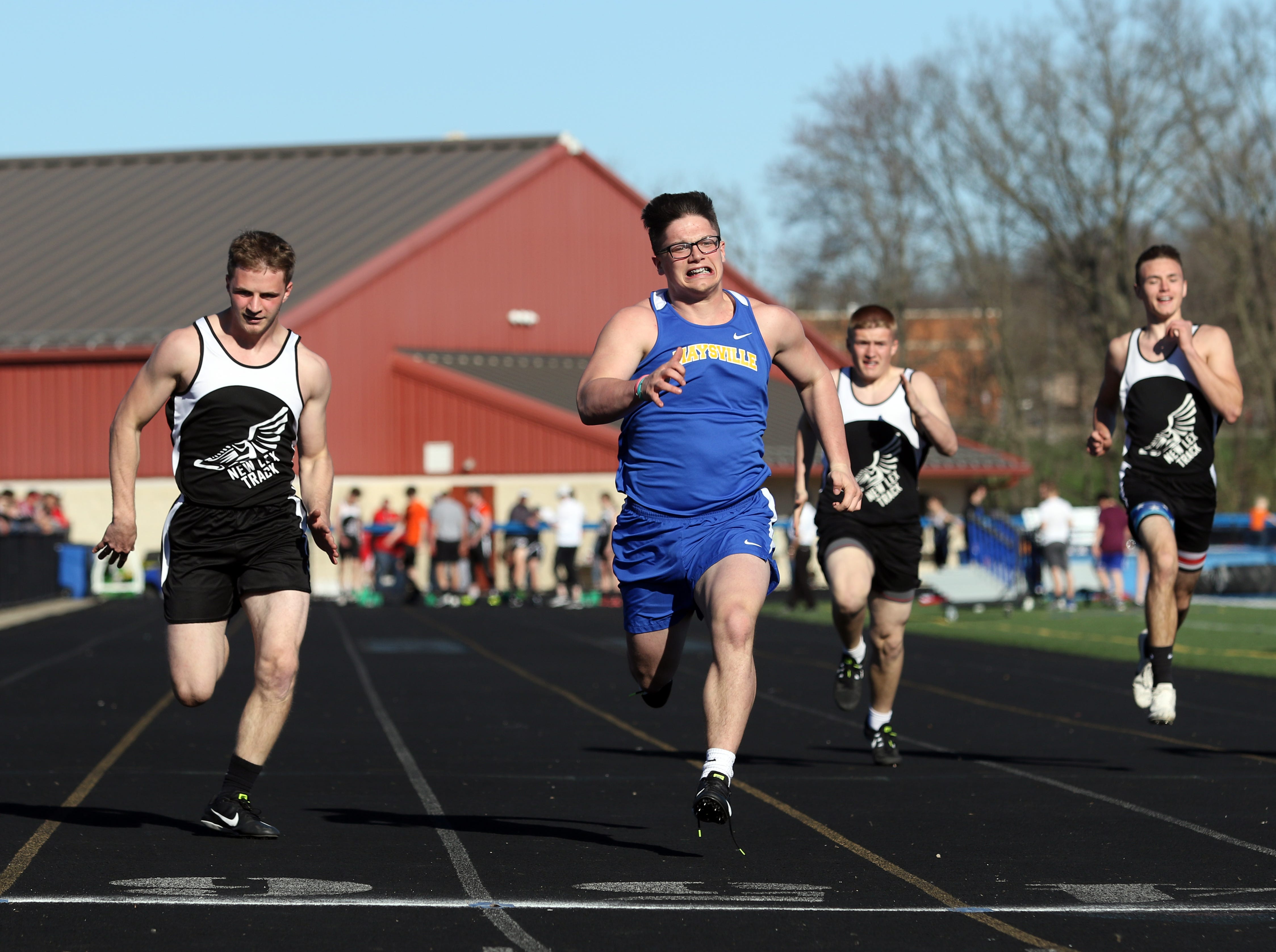 Maysville's Eastin Smith wins his heat of the 100 meter dash during Tuesday's tri-meet between Sheridan, New Lexington and host Maysville.