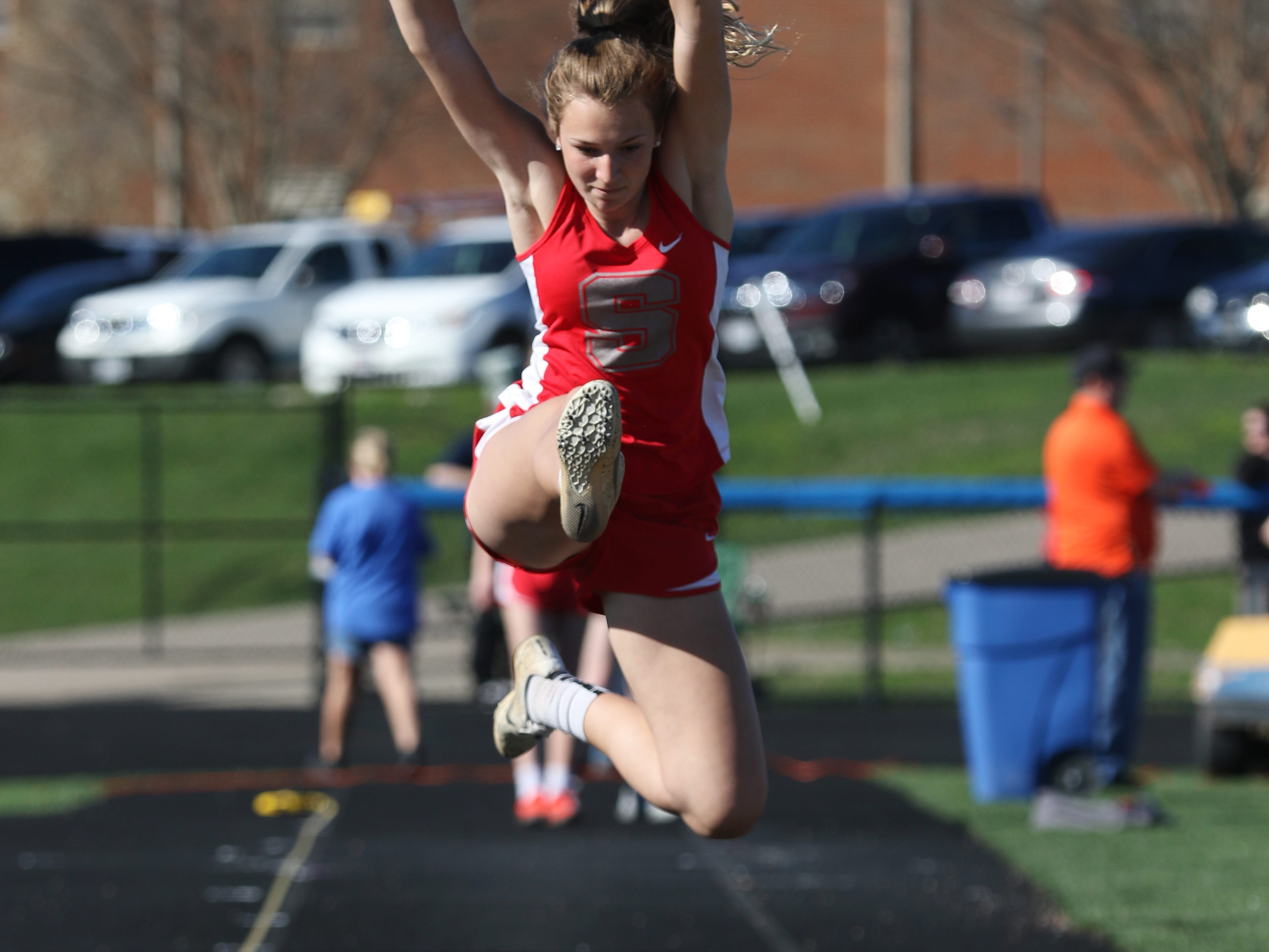 Sheridan's Katelyn Heath competes in the long jump during Tuesday's tri-meet between Sheridan, New Lexington and host Maysville.