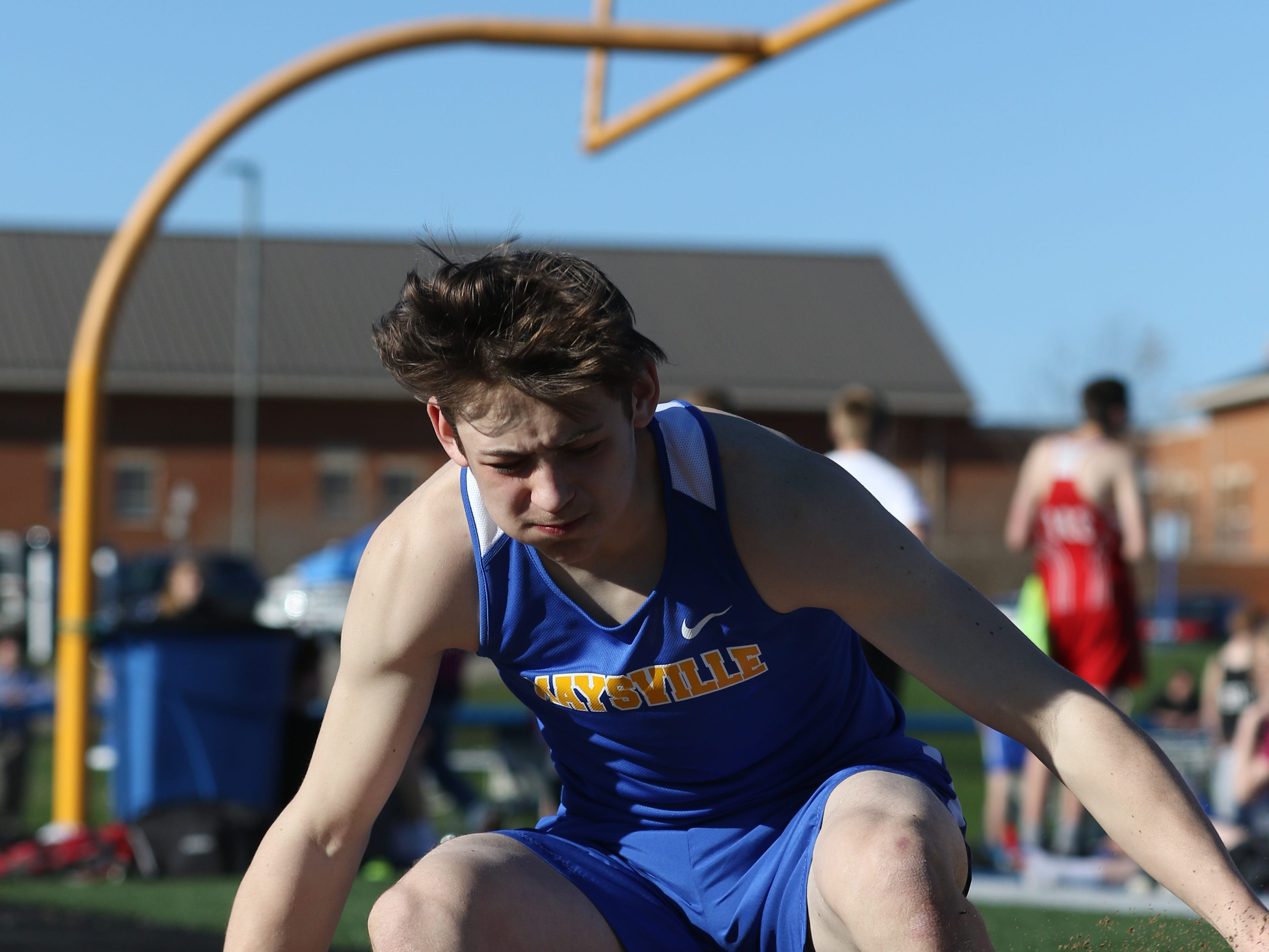 Maysville's Eli Brooks competes in the long jump during Tuesday's tri-meet between Sheridan, New Lexington and host Maysville.