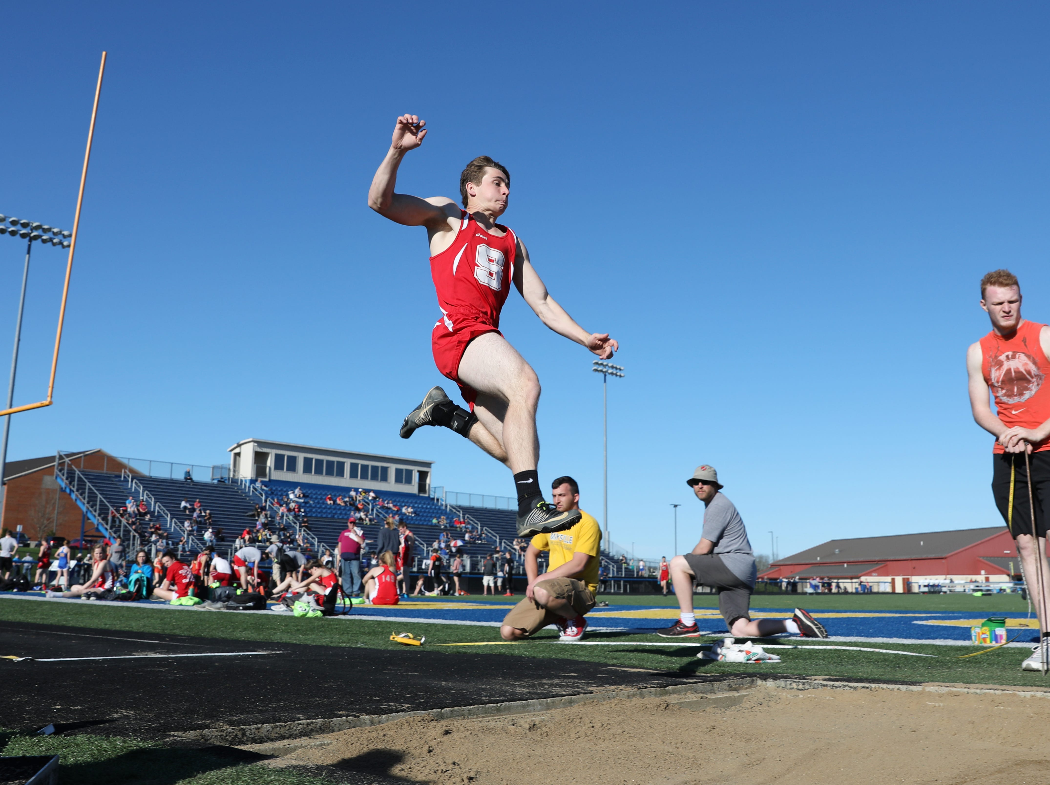 Sheridan's Kyler Altier competes in the long jump during Tuesday's tri-meet between Sheridan, New Lexington and host Maysville.