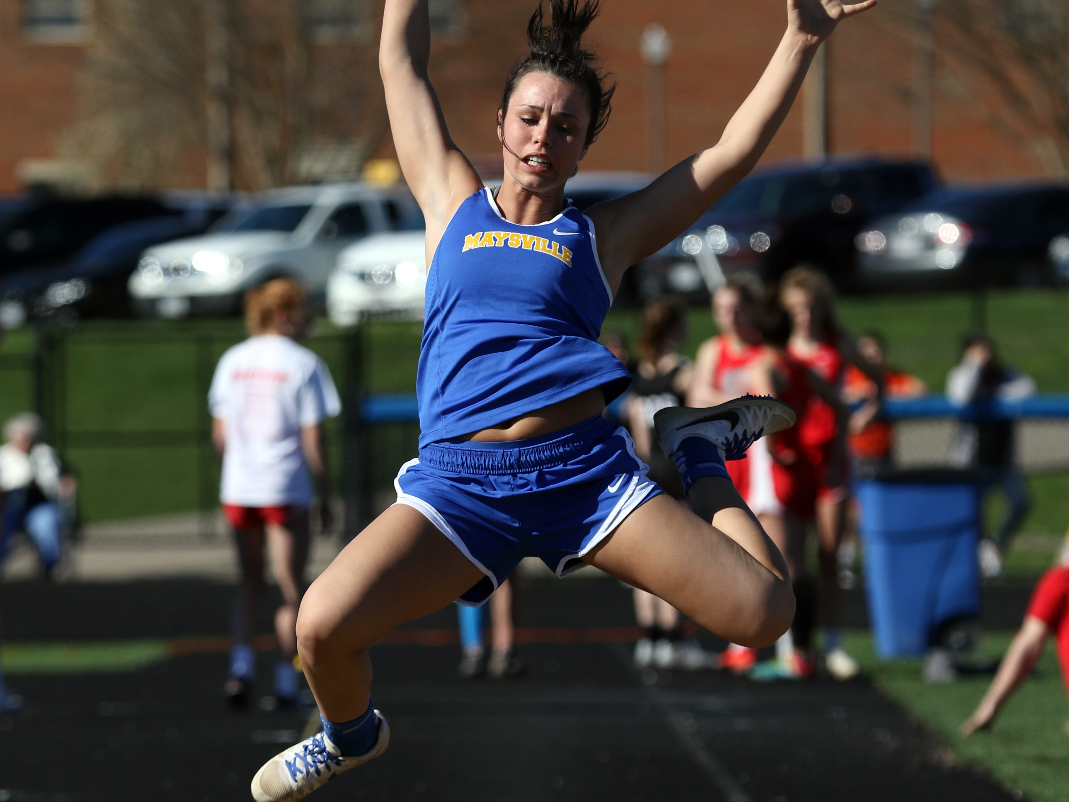 A Maysville jumper competes in the long jump during Tuesday's tri-meet between Sheridan, New Lexington and host Maysville.
